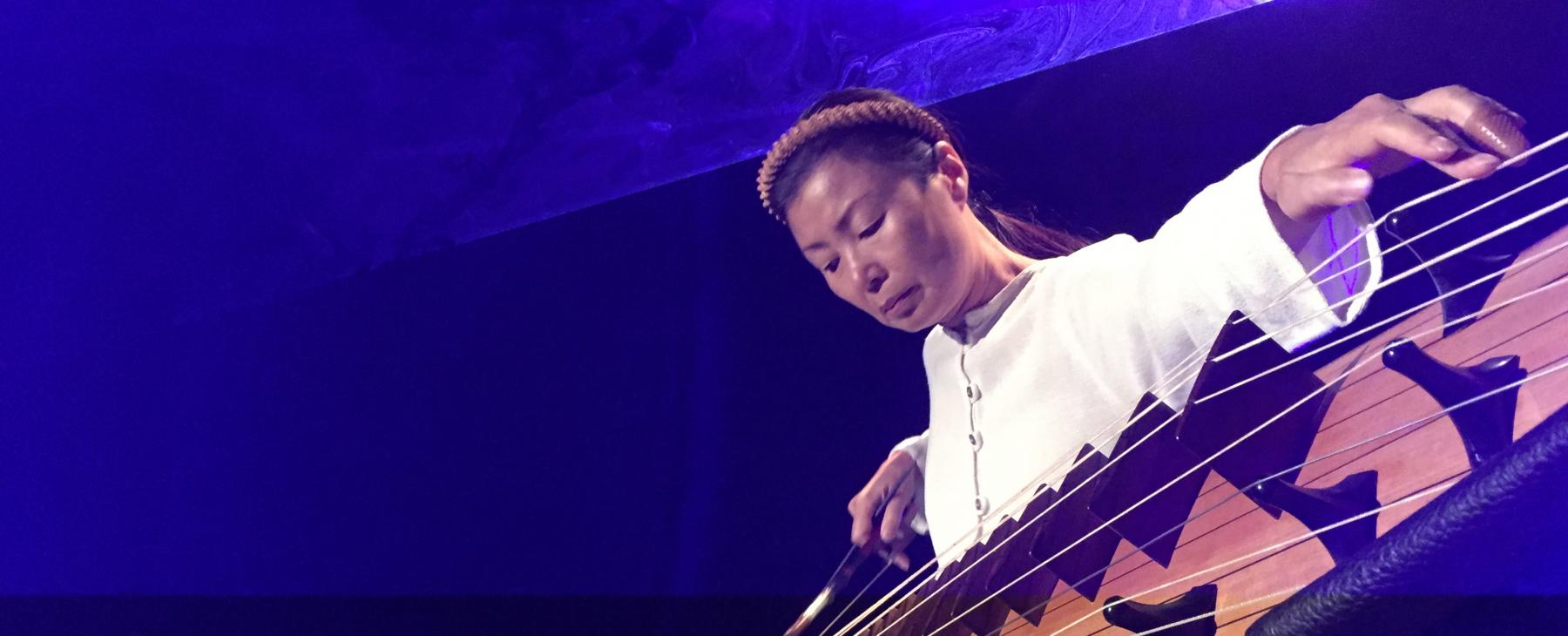 Jin Hi Kim plays the electric komungo, a long stringed instrument.