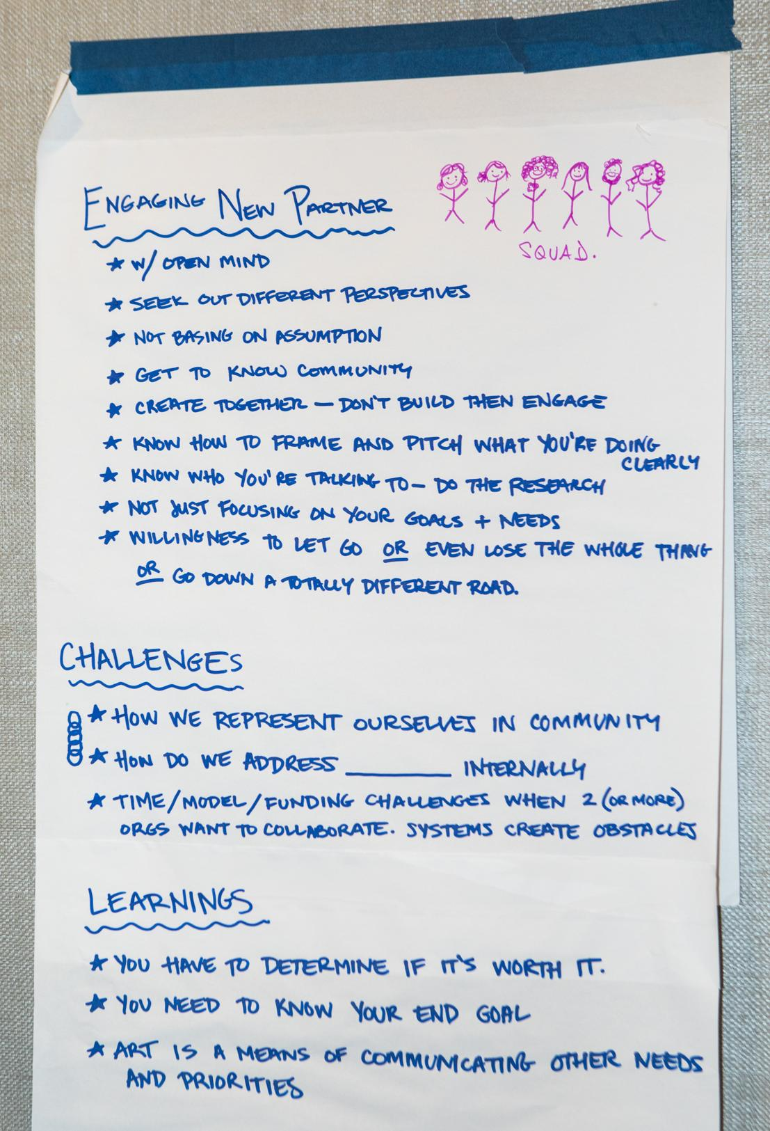 A flip chart page on a wall with notes from a conversation on engaging new partners