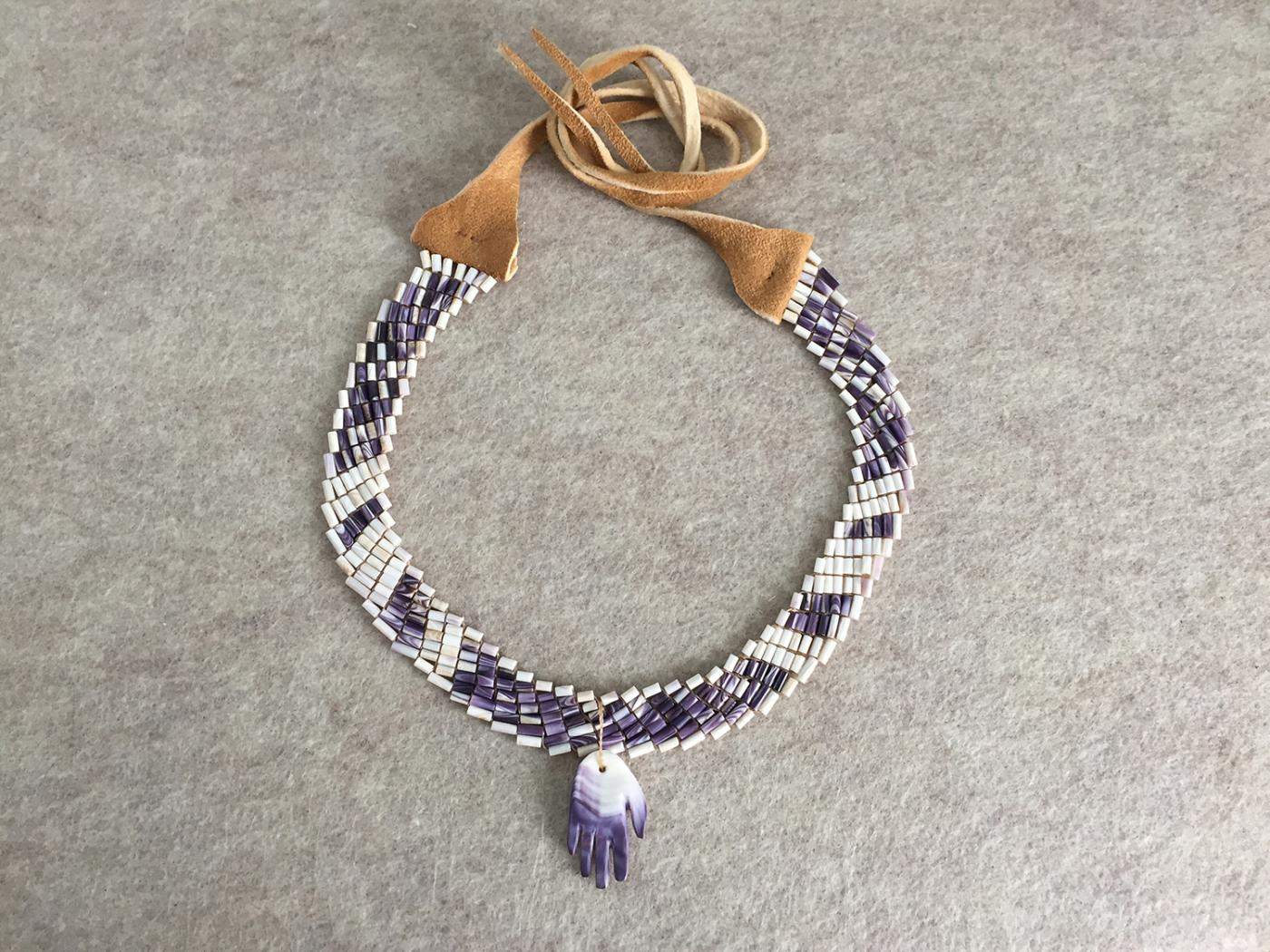 A stone and leather collar, or necklace.