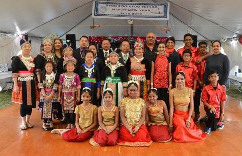 Dancers from Hmong United Association of Rhode Island and India Association of Rhode Island pose together after performing
