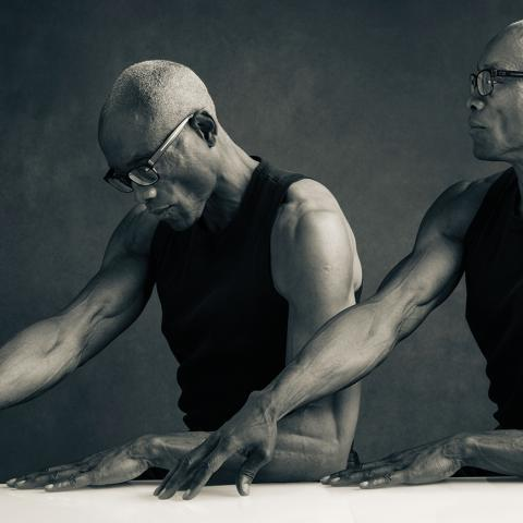 A man is photoshopped next to another version of himself with his head down.