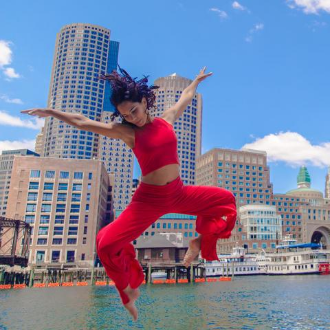Marsha Parilla leaps by the waterfront