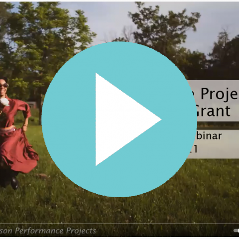 "A light blue play button over a slide that reads ""National Dance Project."""