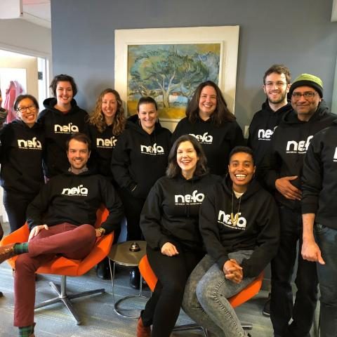 NEFA staff wearing sweatshirts with the NEFA logo